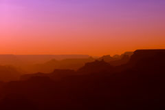 Panoramic View of Grand Canyon in red and purple colors after sunset Royalty Free Stock Photography