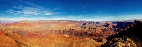 Panoramic view of Grand Canyon on sunny day. Stock Photos