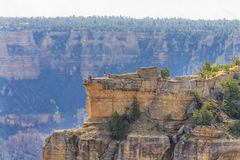 Panoramic view of Grand Canyon, view point at south rim. View of Grand Canyon and view point at south rim. Few people visible at vista point. Arizona, USA royalty free stock images