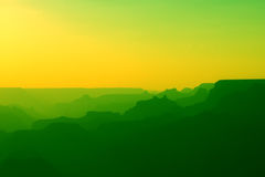 Panoramic View of Grand Canyon in yellow and green colors after sunset Royalty Free Stock Photography