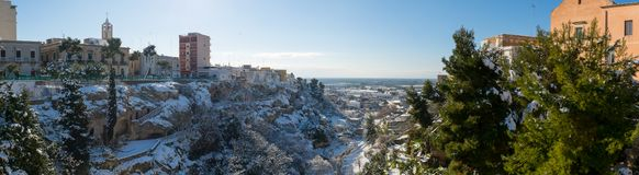 Panoramic View of the Gravina of the Town of Massafra, Covered by Snow on Blue Sky Background stock photo
