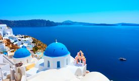 Oia in Santorini. Panoramic view with Greek orthodox church with blue domes and sea in Oia in Santorini, Greece stock images