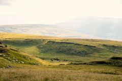 Panoramic view of green hill valley in caucasian mountains in sunny day Royalty Free Stock Image