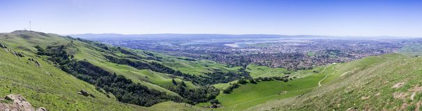Panoramic view the green hills of south San Francisco bay from Mission peak. Monument Peak on the left; San Jose, Milpitas, Fremont and Newark in the royalty free stock photo