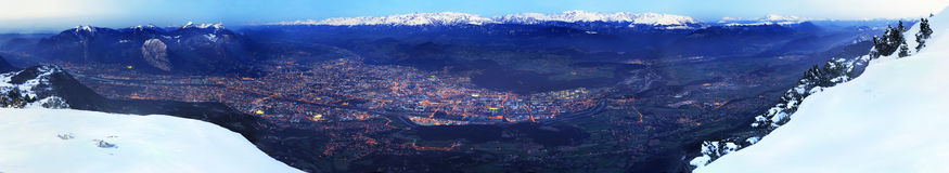 Panoramic view of Grenoble (France) in Winter. A 180? view over the city of Grenoble at dawn in witer. Mont Blanc can be seen away on the left. France royalty free stock photos