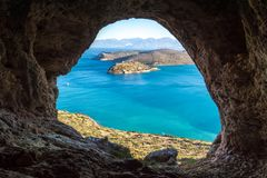 View of the island of Spinalonga with calm sea. Here were isolated lepers, humans with the Hansen`s desease, gulf of Elounda. Panoramic view of the gulf of Royalty Free Stock Photography