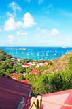 Panoramic view of Gustavia harbour seen from Corossol, hill, red roofs, St Barth, sailboats Stock Photos