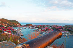 Panoramic view of Gustavia harbour at sunset, old cannon, hill, St Barth, sailboats. The island of St Barth, St. Barts, Saint-Barthélemy, French West Indies stock photo