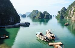 Panoramic view of Ha Long Bay islands, tourist boat and seascape from Bo Hon Island, Ha Long, Vietnam.  stock image