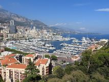 Panoramic view of harbor with boats and skyline of Monaco on sunny summer day, French Riviera, Monaco stock photo