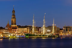 Panoramic View of the port of Hamburg. At blue hour with museum ship Rickmer Rickmers and St. Michaelis-church Stock Photos