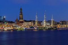 Panoramic View of the port of Hamburg. At blue hour with museum ship Rickmer Rickmers and St. Michaelischurch Royalty Free Stock Photo
