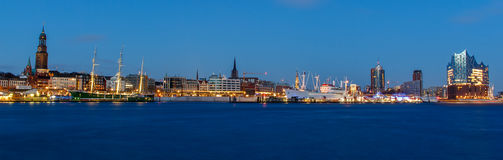 Panoramic View of the port of Hamburg. At blue hour with museum ships Cap San Diego and Rickmer Rickmers, with St. Michaelischurch and Elbphilharmonie Stock Photography