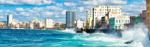 Panoramic view of the Havana skyline. Waves crashing into the Malecon seawall Royalty Free Stock Photo
