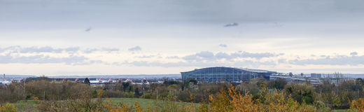 Panoramic View of Heathrow Terminal 5. Taken from a nearby hill. The terminal has experienced problems with replacing lights many of which are not working Royalty Free Stock Images