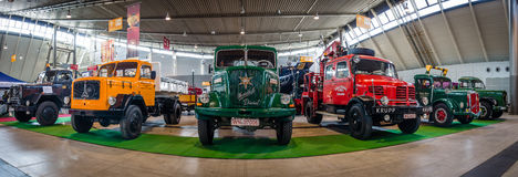 Panoramic view of the heavy trucks of various brands and models. Stock Photography