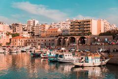 View of heraklion city old port boats buildings sky sea with shifted color hue vibrant colors fresh summertime. Panoramic view of heraklion city old port boats stock photo