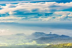 Panoramic view from a high green hill to the sea, islands, rice terraces, fields and forests in indonesia, Agung volcano slope. Panoramic view from a high green stock images