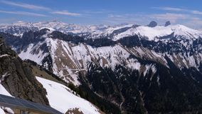 Panoramic view from the high mountain to snowy peaks in Switzerland Alps. Rochers-de-Naye. stock video