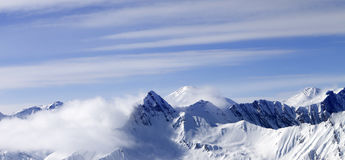 Panoramic view on high mountains in haze Royalty Free Stock Photography