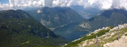 Panoramic view of high mountains and a lake Stock Photos