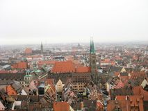 Panoramic view of the old town of Nuremberg in wintertime. Panoramic view from the hill to the brown tile roofs of the houses in the old town of Nuremberg in Royalty Free Stock Image