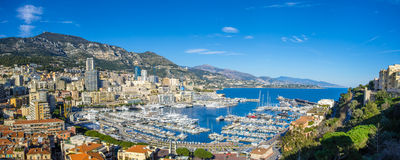 Panoramic view on the hills and harbor of Monaco stock image