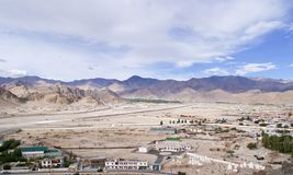 The panoramic view of the Himalayan mountains shot atop Shey Palace, Leh. A scenic and panoramic view of the Himalayan mountain ranges on the backdrop of the Stock Photo