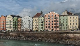 Panoramic view of the historic city center of Innsbruck with colorful houses along Inn river and famous Austrian mountain. INNSBRUCK, AUSTRIA - JANUARY, 01 2019 royalty free stock images