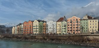 Panoramic view of the historic city center of Innsbruck with colorful houses along Inn river and famous Austrian mountain. INNSBRUCK, AUSTRIA - JANUARY, 01 2019 stock photography