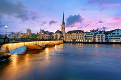 Panoramic view of historic Zurich city center with famous Fraumunster Church and river Limmat at Lake Zurich , in twilight, Canto royalty free stock photography