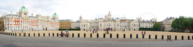 Panoramic view of Horse Guards Parade. London, England. Panoramic view of Horse Guards Parade and Household Cavalry Museum. The London Eye can be seen in the Stock Photos