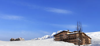 Panoramic view on hotels in winter mountains Stock Images