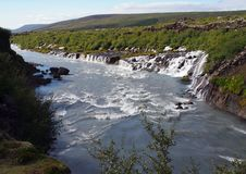 Panoramic view of Hraunfossar waterfall in Island royalty free stock photography