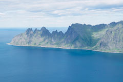 Panoramic View from Husfjellet Mountain to Devils Teeth. Panoramic View from Husfjellet Mountain on Senja Island Norway royalty free stock photos