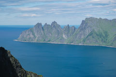 Panoramic View from Husfjellet Mountain to Devils Teeth. Panoramic View from Husfjellet Mountain on Senja Island Norway royalty free stock images