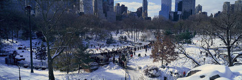 Panoramic view of ice skating Wollman Rink in Central Park, Manhattan, New York City, NY after winter snowstorm Royalty Free Stock Images