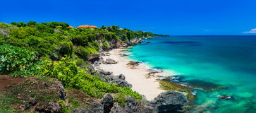 Panoramic view of idyllic tropical beach with yellow sand and perfect azure clean water Royalty Free Stock Images