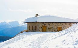Panoramic view of idyllic winter wonderland with mountain tops and traditional mountain chalet in the Dolomites royalty free stock photos