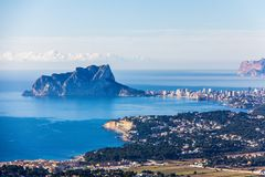 Panoramic view of Ifach Rock Natural Park or `Penon de Ifach ` and Calpe city in Spain stock images