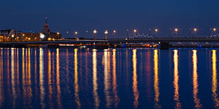 Panoramic view of illuminated bridge in Riga Stock Image