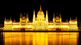 Panoramic view of illuminated Hungarian Parliament on Danube River Embankment in Budapest by night Stock Photos