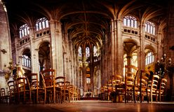 Panoramic view inside a church with chairs royalty free stock images