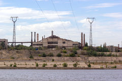 Panoramic view of ironworks on river coastline Stock Images