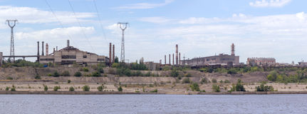Panoramic view of ironworks on river coastline Royalty Free Stock Photography