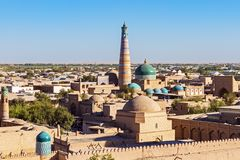Panoramic view of Islam Khodja Minaret and mosque - Khiva, Uzbek. Panoramic view of Islam Khoja Minaret and moque in Itchan Kala, the inner town of the city of Royalty Free Stock Image