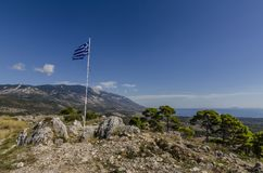 Greek flag waving at the fort of Agios Georgios Kefalonia. Panoramic view of the island of kefalonia and greek flag waving from the ruins of the old fort of Royalty Free Stock Images