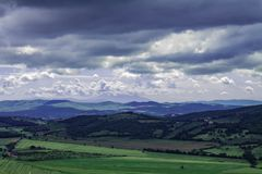 Panoramic view of the italian tuscany. The mountains in the distance are covered by clouds royalty free stock photo