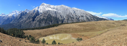 Panoramic view of the Jade Dragon Snow Mountain in Yunnan, China Royalty Free Stock Photo