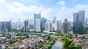 Panoramic view of Jakarta cityscape at sunny day. JAKARTA - Indonesia. March 12, 2018: Panoramic view of Jakarta cityscape with residential houses, modern office royalty free stock photo
